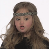 Young girl with down syndrome speaking to the camera. This is a screenshot from the video in the story.
