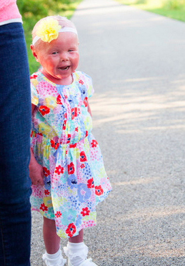 author's daughter in flower dress smiling