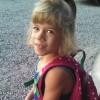 little girl wearing a backpack