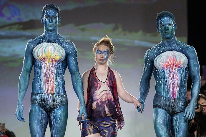 Madeline Stuart walking the runway with two men at 2015 NYFW