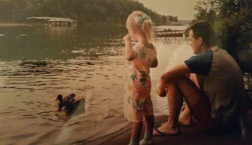 girl and dad looking at lake
