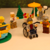 A lego figure in a wheechair
