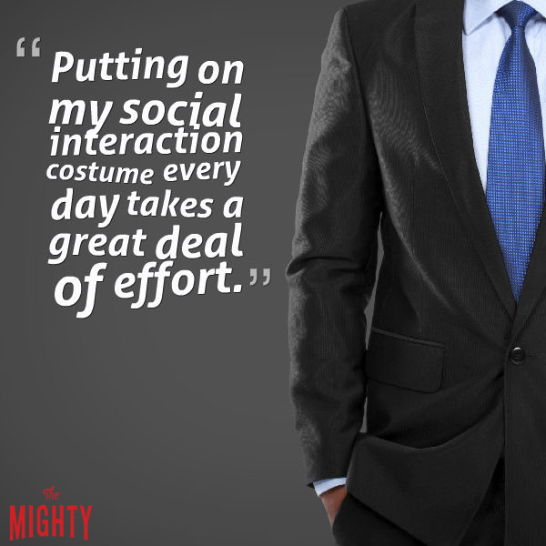 "Image: Close-up of a man standing in a suit with a blue tie. Text reads: ""Putting on my social interaction costume every day takes a great deal of effort."""