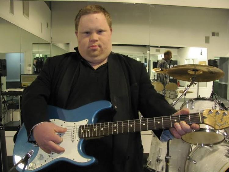 Ethan Saylor with a guitar