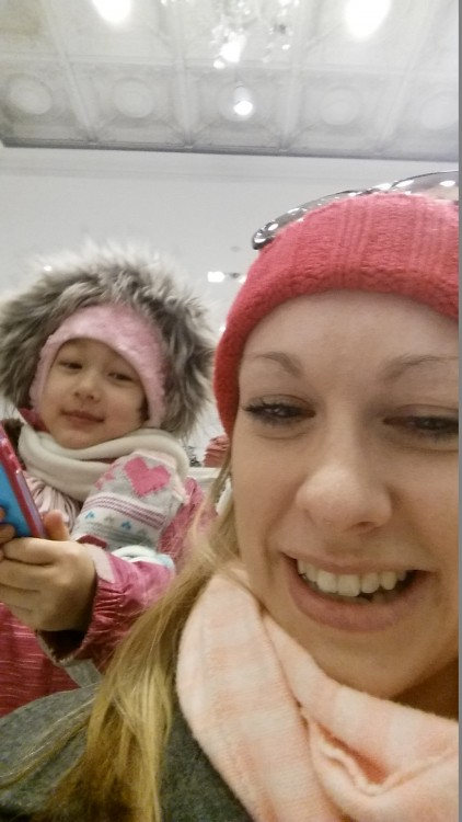 Woman in Pink Hat and Baby