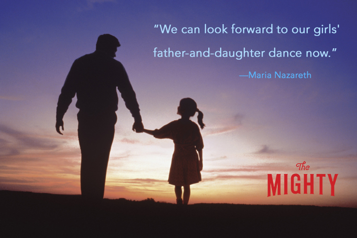 Silhouette of father and daughter walking