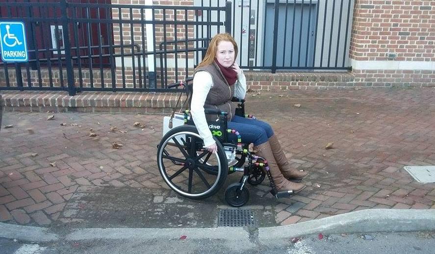 Woman in a wheelchair on a sidewalk