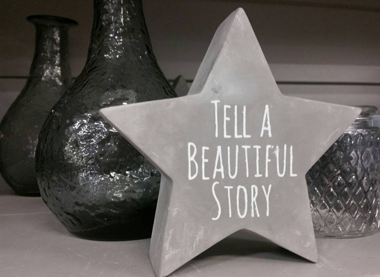 """A grey star that says, """"Tell a beautiful story."""""""