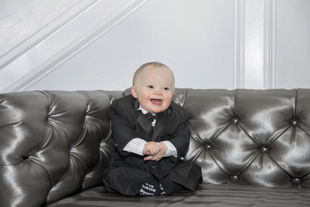 baby in tuxedo