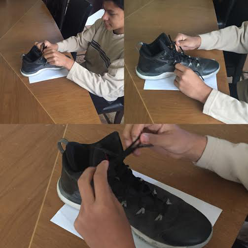 Peter learning to tie his shoes
