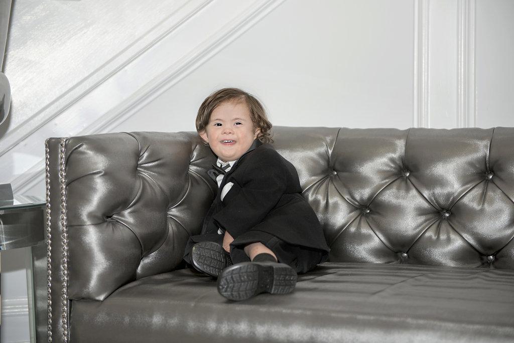 little boy sitting in tux
