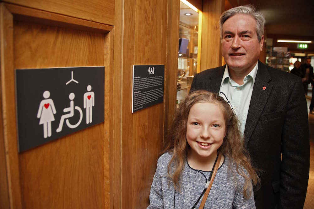 Iain Gray MSP and 10 year old Grace Warnock, a school pupil from Prestonpans in East Lothian, unveil a new disabled toilet signs, designed by Grace, which is now in place at the Scottish Parliament's accessible toilets. Grace has Crohn's Disease and, like many other people, uses accessible toilets as they provide the space and facilities to manage the requirements of her condition. Grace came up with the idea of this sign to show that people might not have a visible disability, but may still require to use an accessible toilet. 12 march 2016. Pic - Andrew Cowan/Scottish Parliament