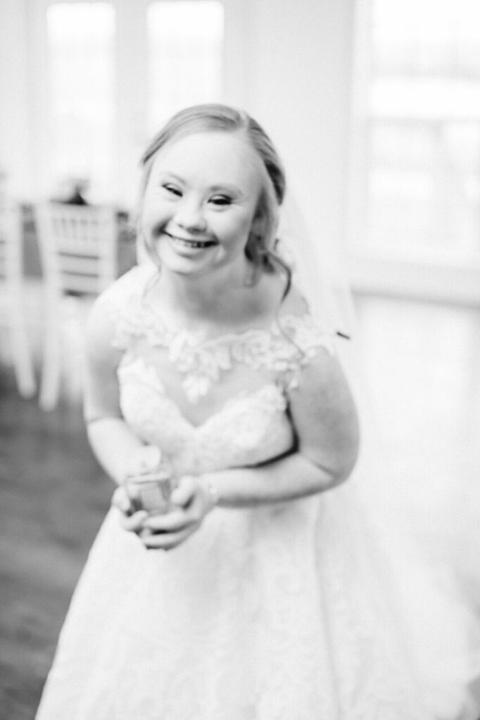 black and white photo, madline stuart smiling in wedding dress