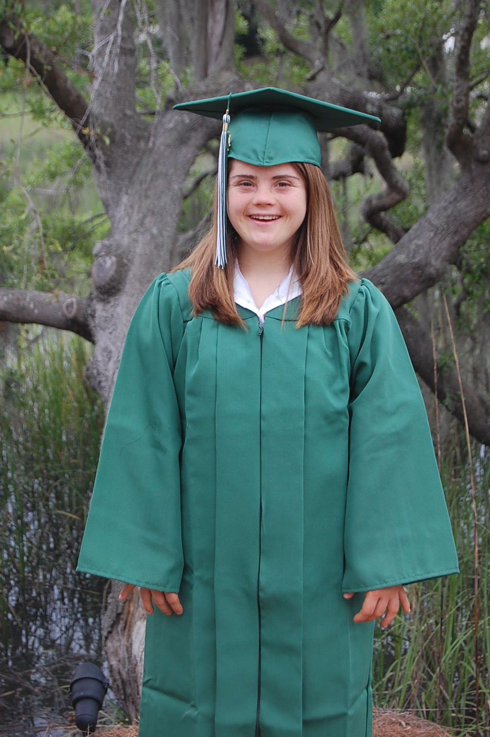 to parents of babies down syndrome on the eve of my hope in her graduation cap and gown