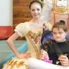 Monica McDivitt's daughter, Samantha, with ballet dancers.