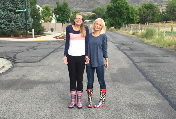 two women standing in the middle of the road