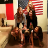 Six female friends making a pyramid