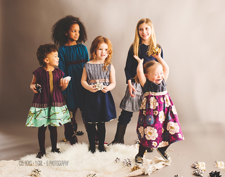 Group of girls modeling, one child has down syndrome
