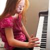 Christina Clapp playing piano