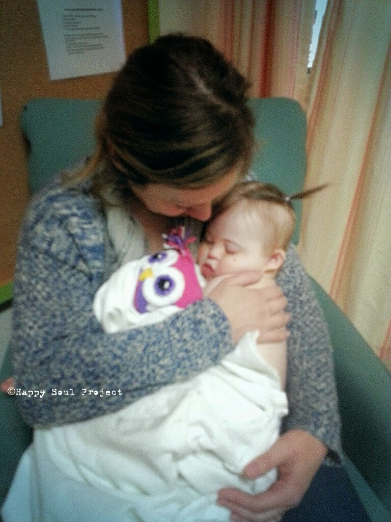 mom holding baby before surgery