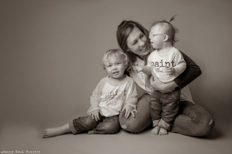 mom sitting with two kids
