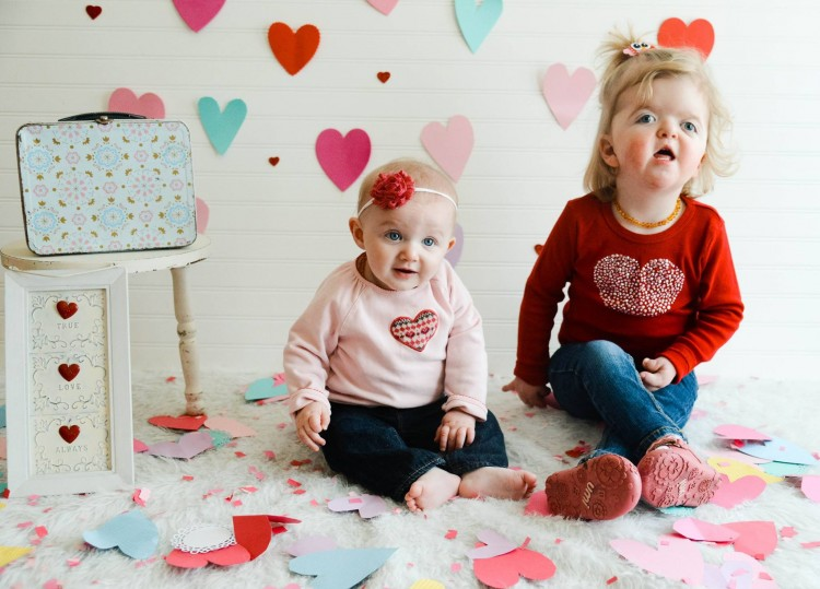 children with paper hearts