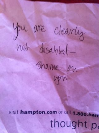 """note reading """"you are clearly not disabled - shame on you."""""""