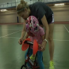 child with down syndrome learns to ride a strider bike