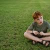 boy sitting on a lawn
