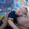 father kisses his son on the cheek