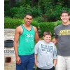 Notre Dame football players with boy