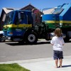 young boy looking at a garbage truck