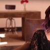 A screenshot of singer, Demi Lovato, talking into a camera