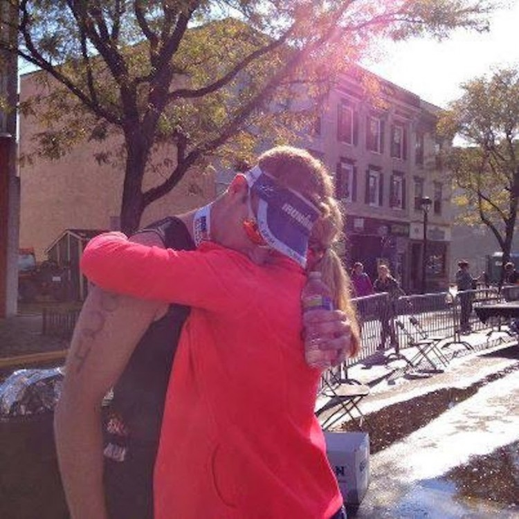The author hugging his wife after participating in a race