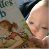baby holds the book charlotte's web