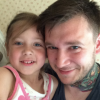 Tattoo artist Jeff Paetzold with his daughter