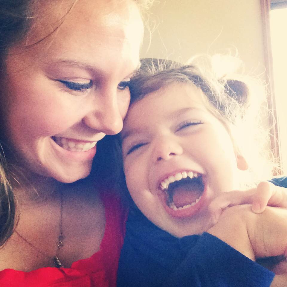 woman and little girl with autism smiling