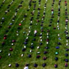 backpacks spread out on college campus lawn to raise awareness for suicide