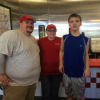 boy with five guys staff