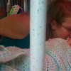 mother kisses young daughter in the hospital