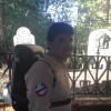 A teenage boy in a Ghostbusters Halloween costume standing outside