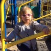 girl playing on jungle gym