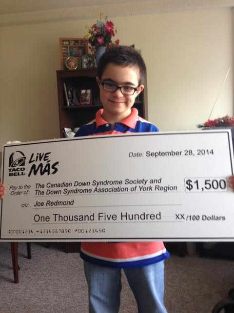 Joe holding the check from Taco Bell