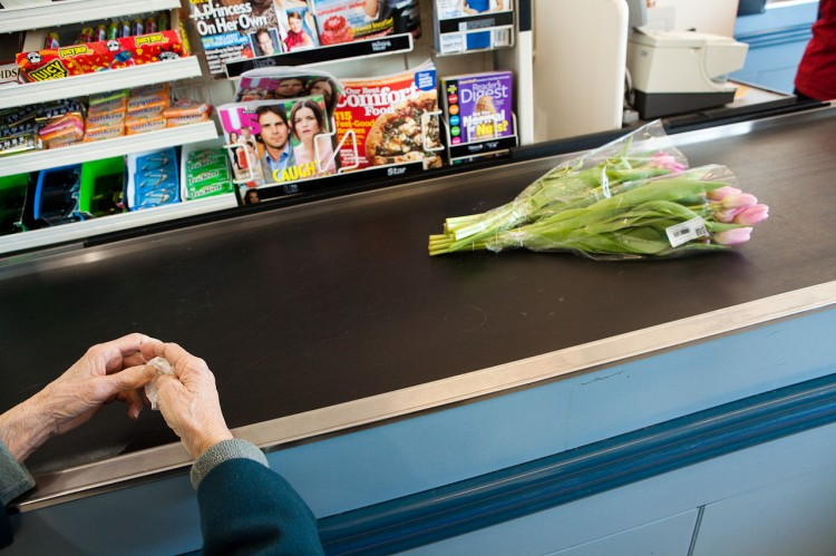Susan's photograph of her aunt buying a bouquet of flowers at a register