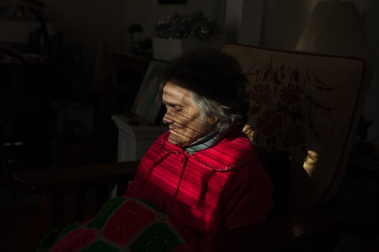 Susan's photograph of her aunt sitting in a dark room with light shining on her face