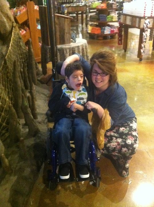 mom next to son in wheelchair
