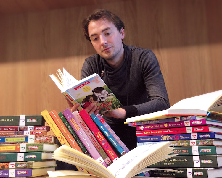 christian boer reading stacks of books