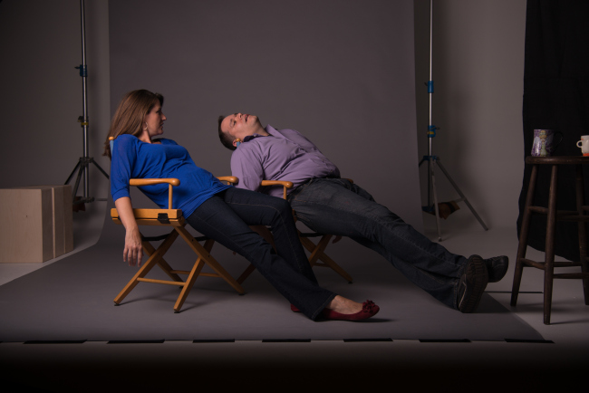 husband and wife slouching on chairs