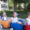 little girls in play cars