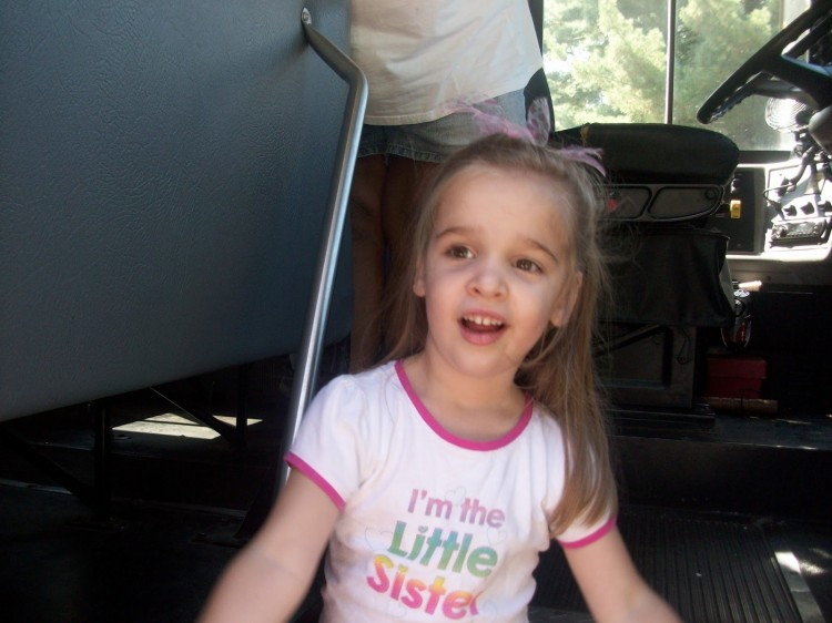 little girl on the school bus